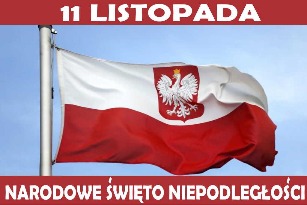 Na zdjęciu biało-czerwoną powiewającą flagę, na której jest Godło Polski - Orzeł Biały oraz napis: 11 listopada - Narodowe Święto Niepodległości